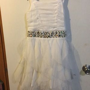 White sparkly dress. Short in front long in back.